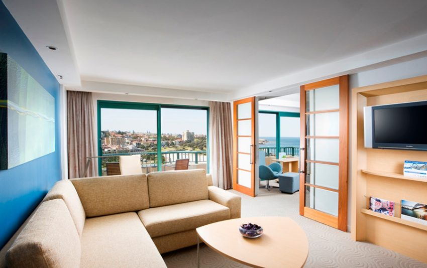 Photograph of Reef Suite lounge room at Crowne Plaza Coogee Beach, Sydney.