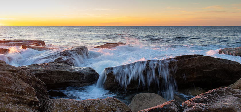 Water splashing over rocks at Coogee