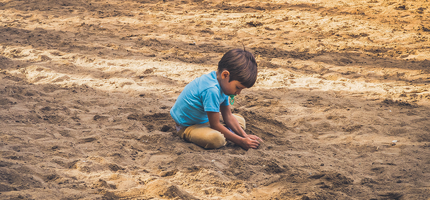 A kid playing on the beach
