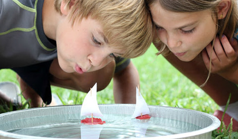 Kids boat making during sunny afternoon